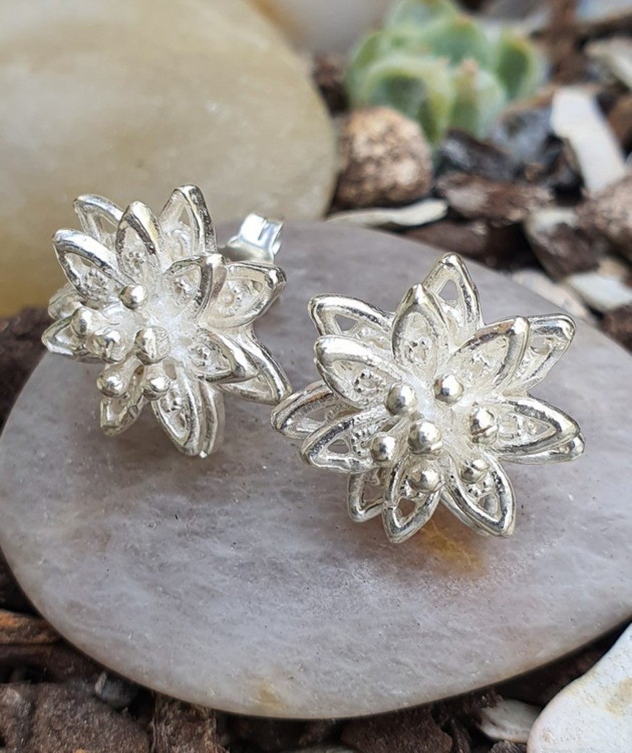 Silver star flower stud earrings image 0