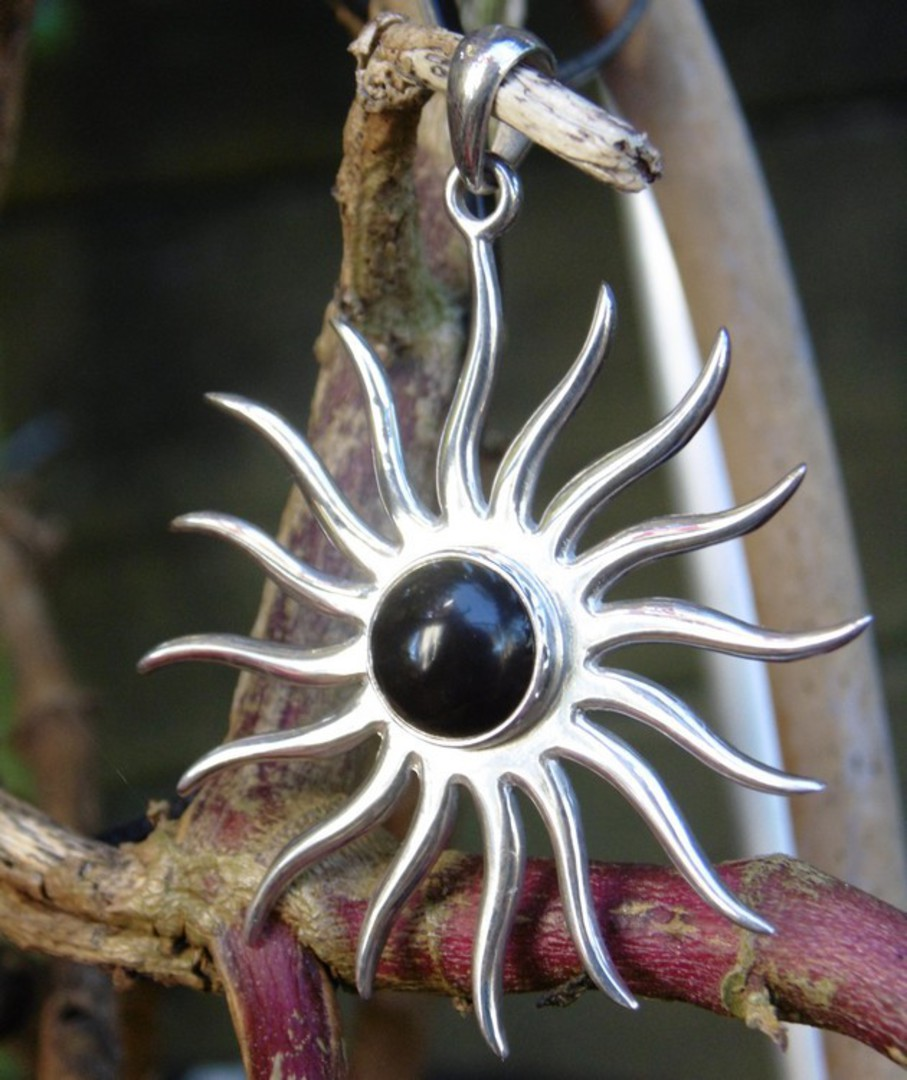 Sterling silver star pendant with black onyx image 1