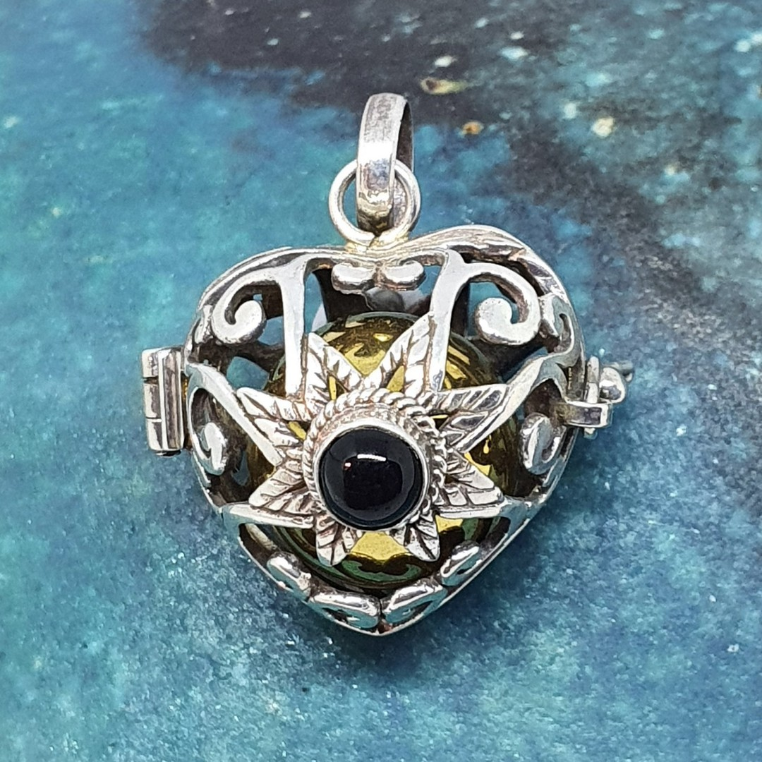Silver filigree harmony ball pendant with black onyx image 0