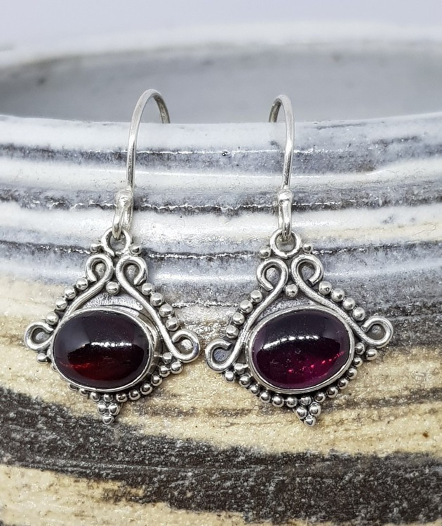 Sterling silver garnet earrings in decorative frame image 0