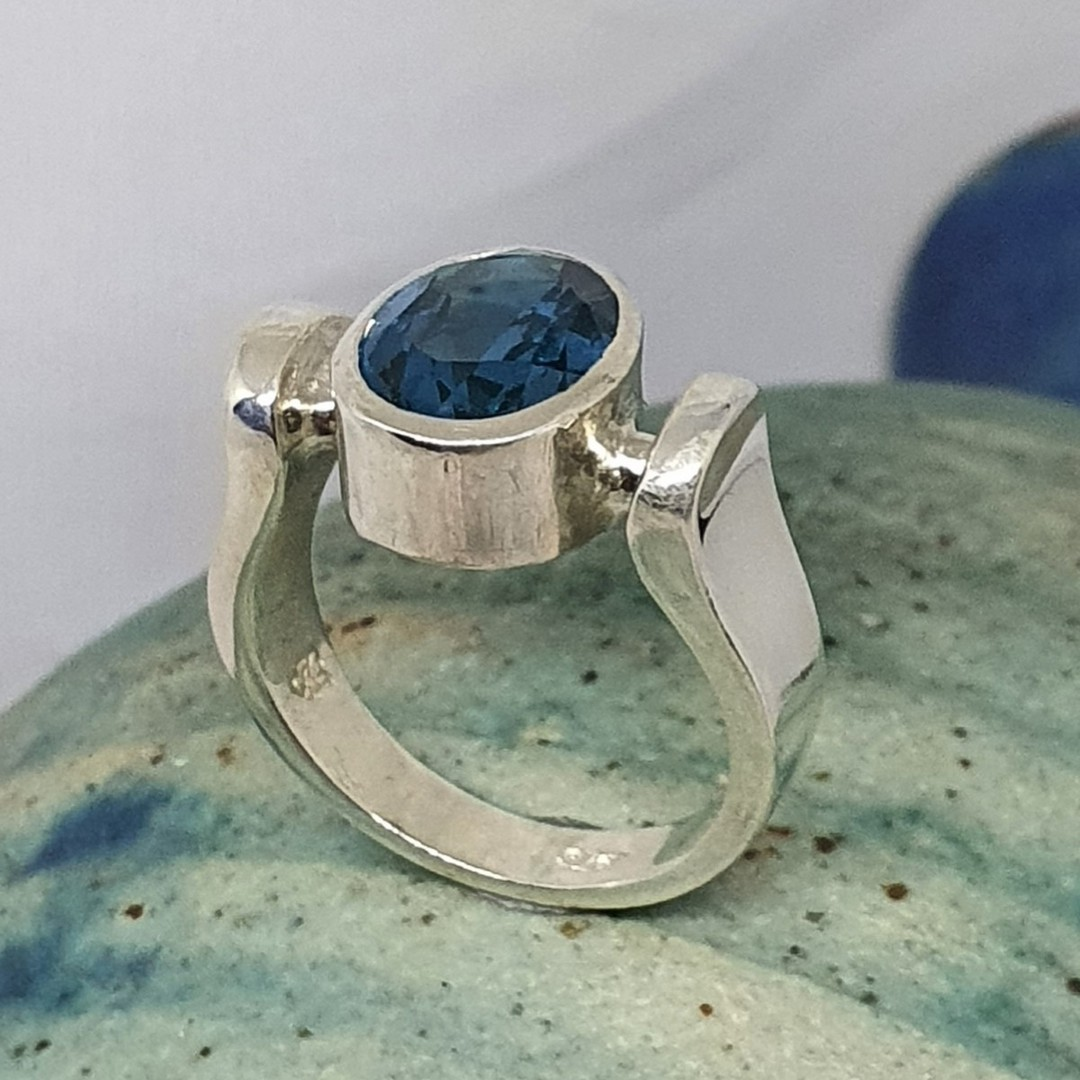 Sterling silver ring with deep blue stone image 0