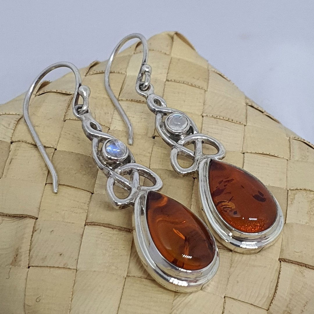 Silver amber earrings with infinity knot and moonstone image 3