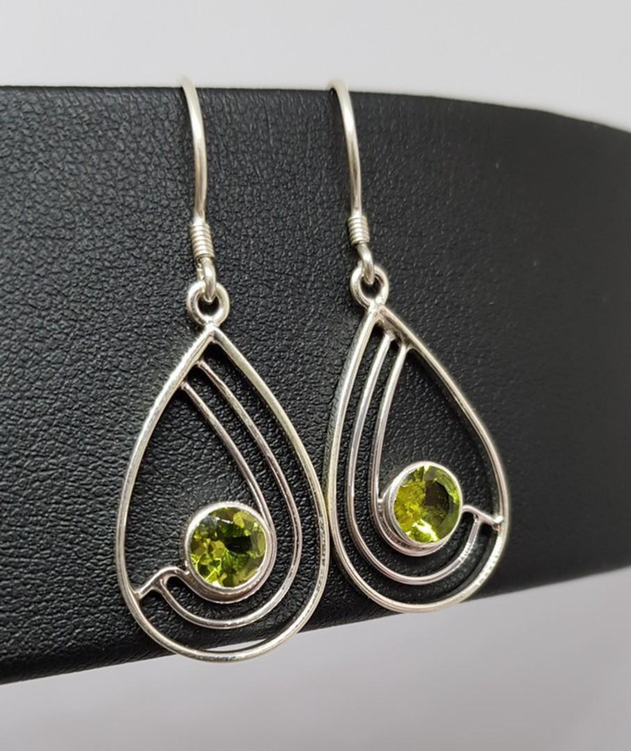 Silver peridot earrings, open teardrop shape image 0