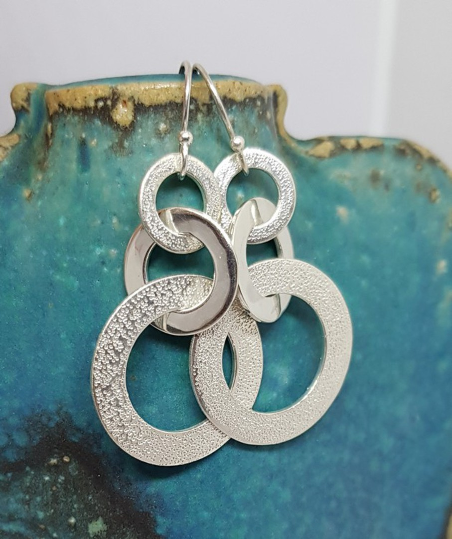 Silver hoop earrings with hammered detail image 0