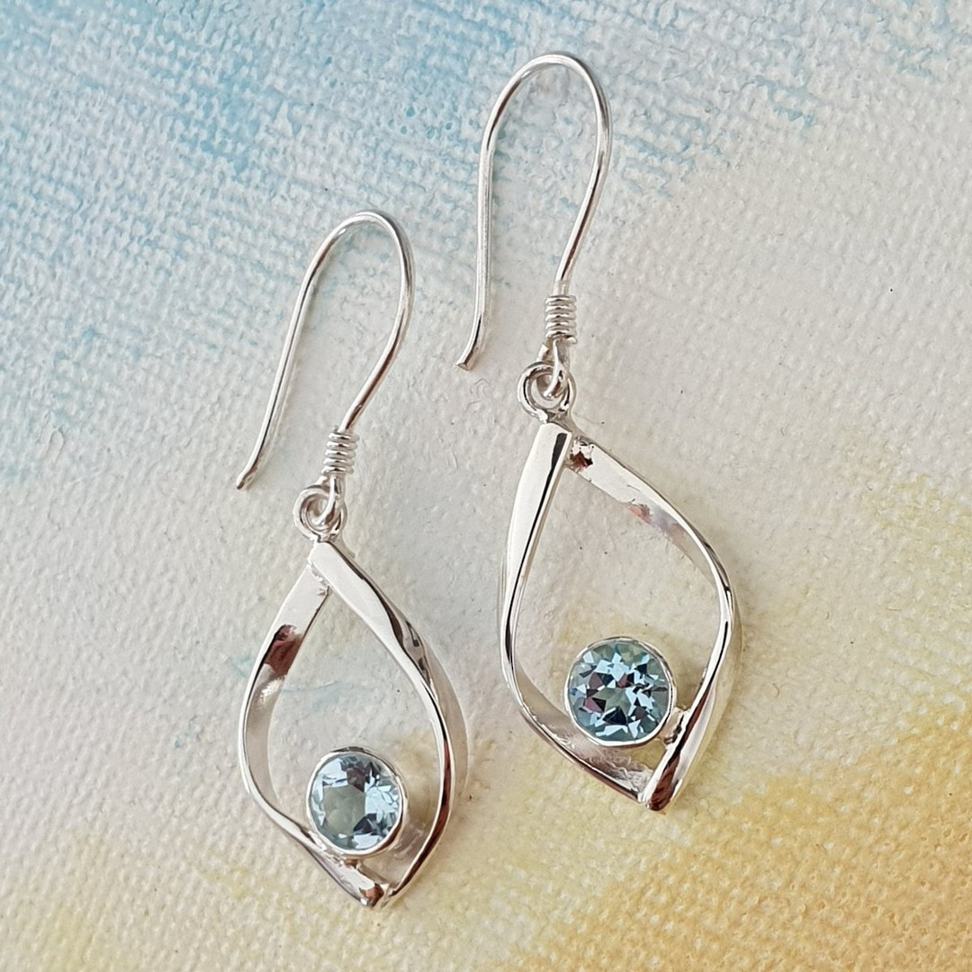 Sterling silver small blue topaz earrings image 0