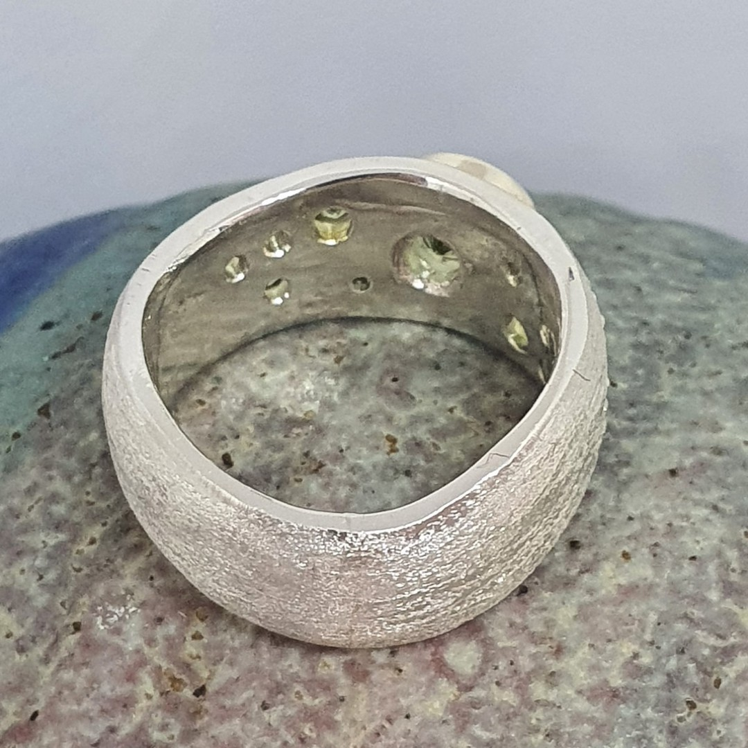 Made in NZ. brushed silver ring with natural peridot image 6