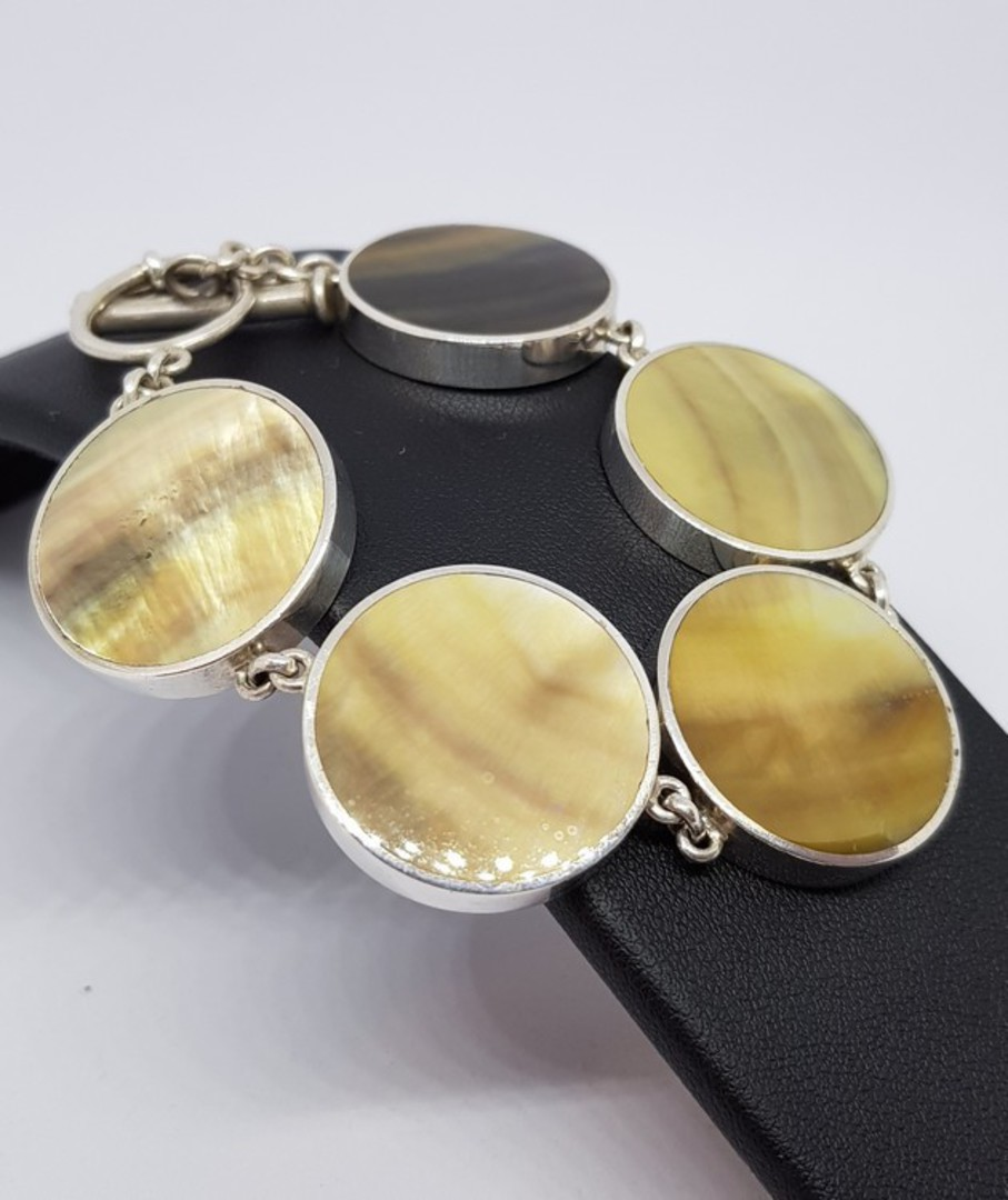 Gold toned shell and silver bracelet image 0