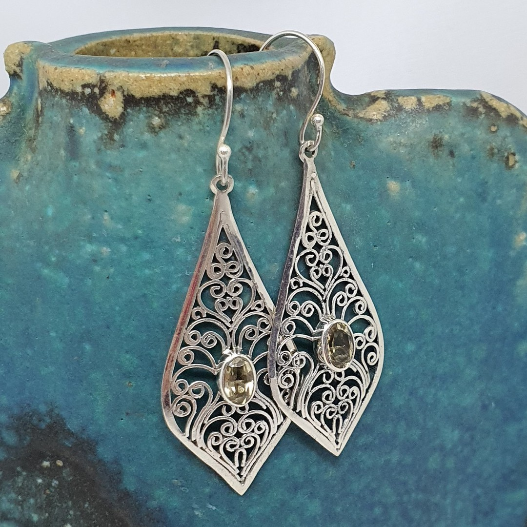 Silver filigree earrings with golden gemstone image 1