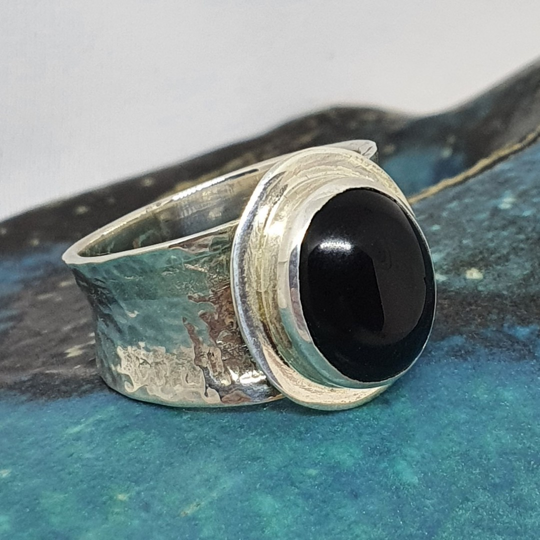 Sterling silver black onyx ring with wide hammered band image 0