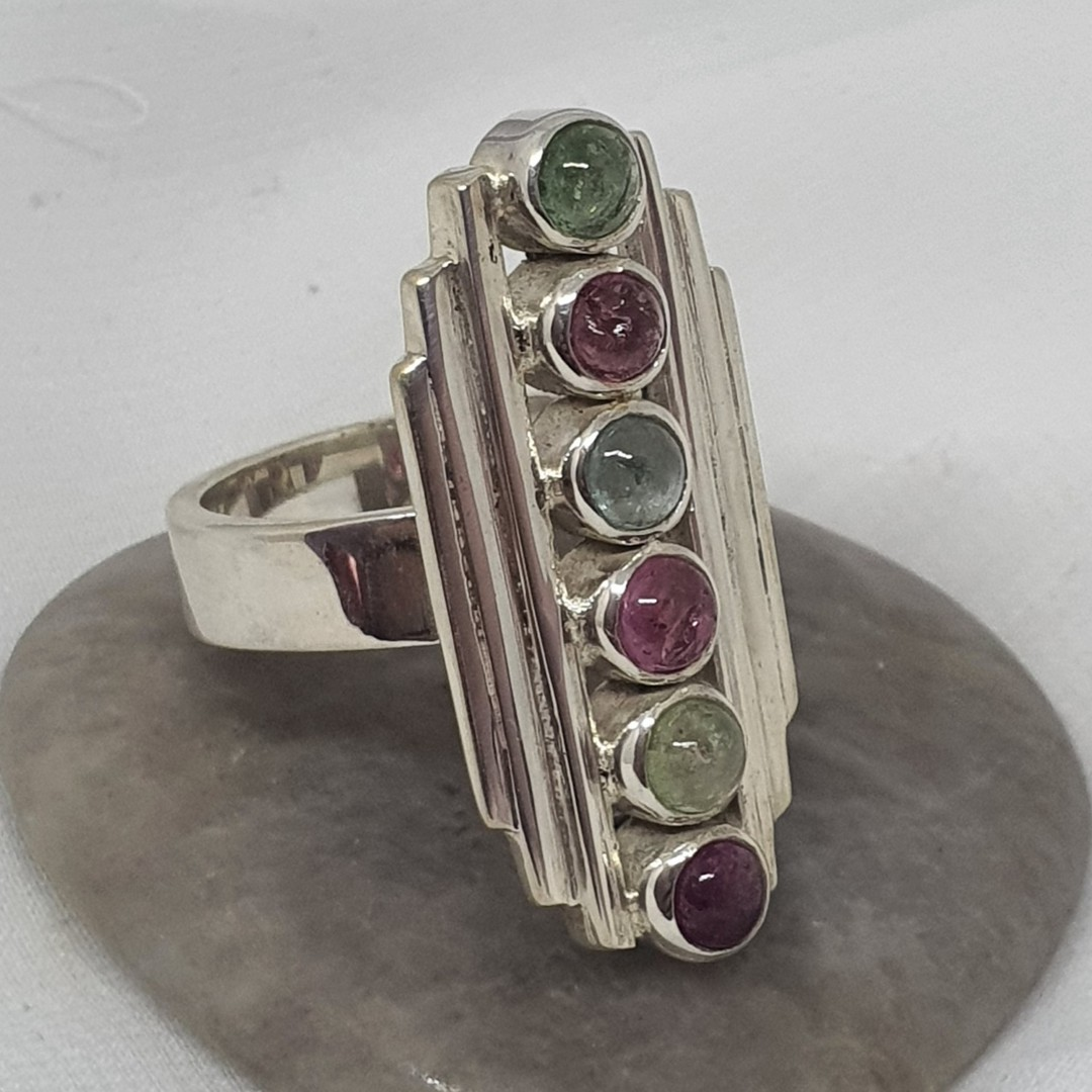 Long rectangle ring with green and red gemstones image 1