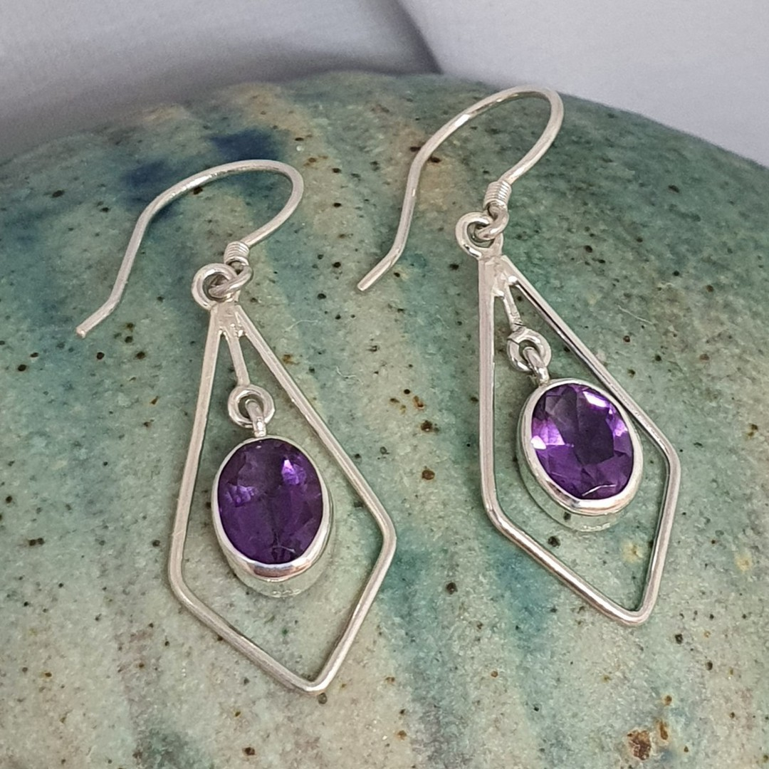 Silver hook earrings with oval purple gemstone image 1
