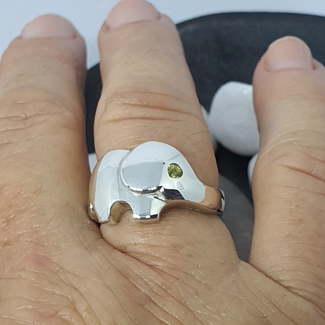 Sterling silver elephant ring with green sapphire image 1