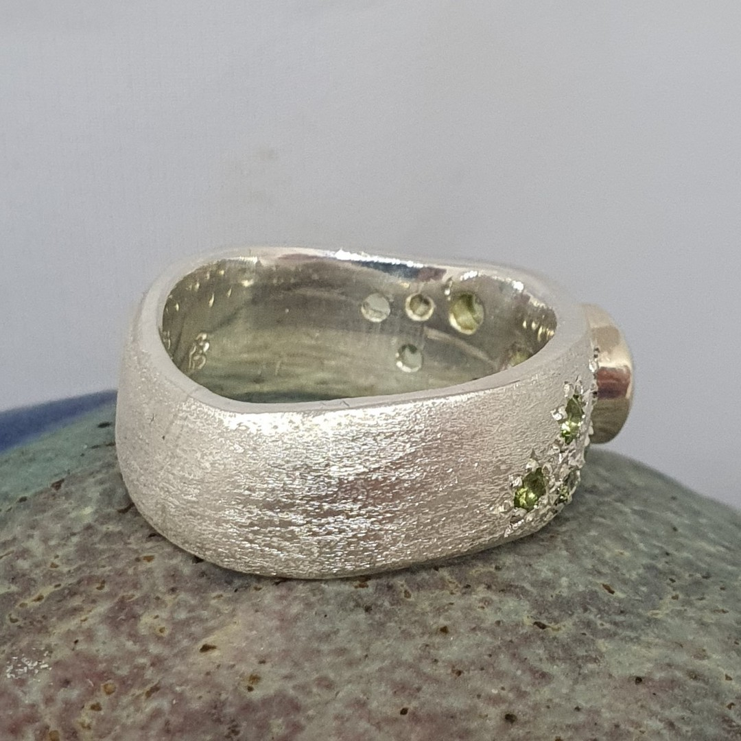 Made in NZ. brushed silver ring with natural peridot image 4