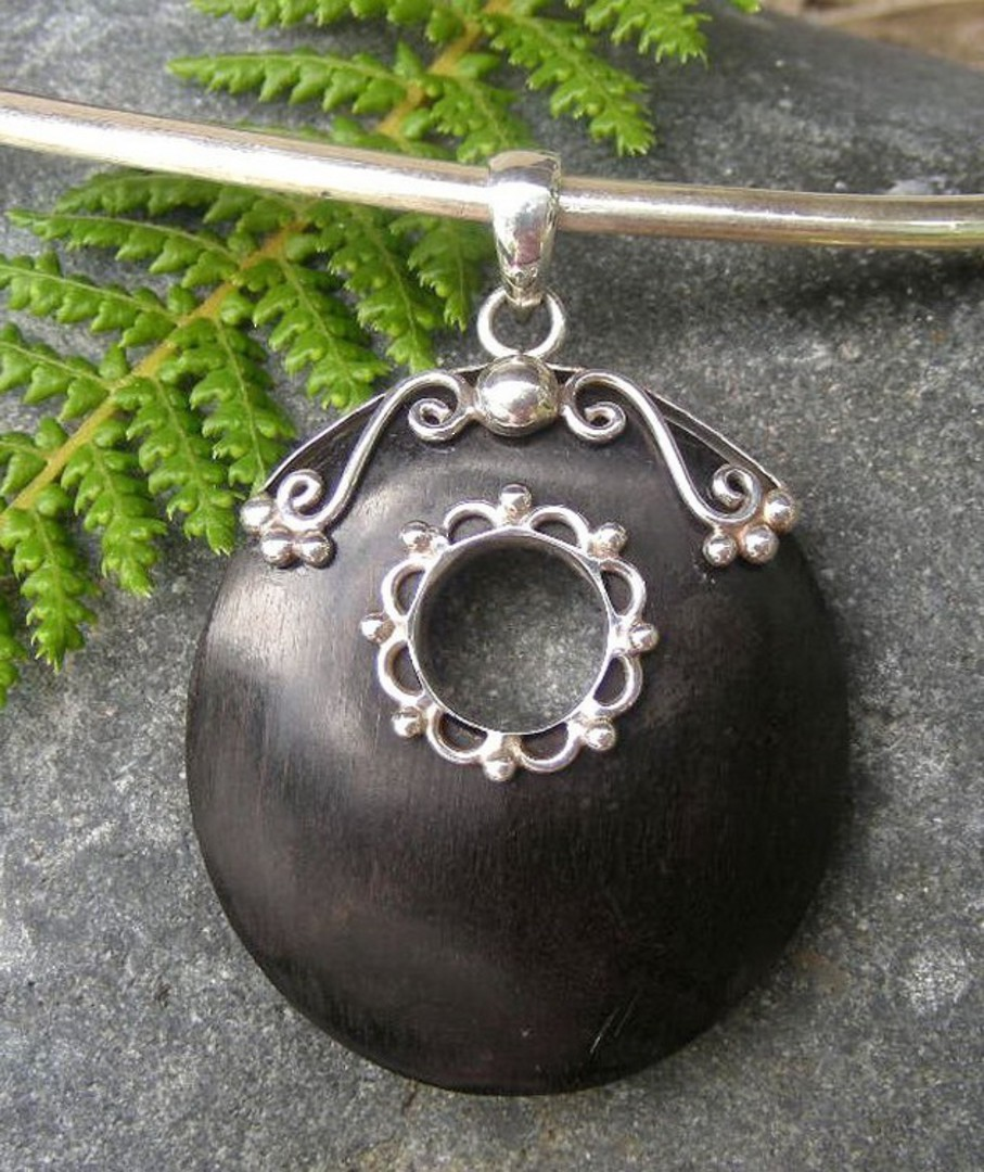 Polished wooden pendant with silver detailing - now on sale image 1