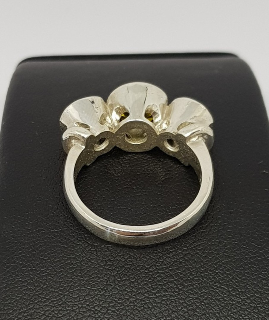 Silver synthetic perdiot ring with two cz image 1