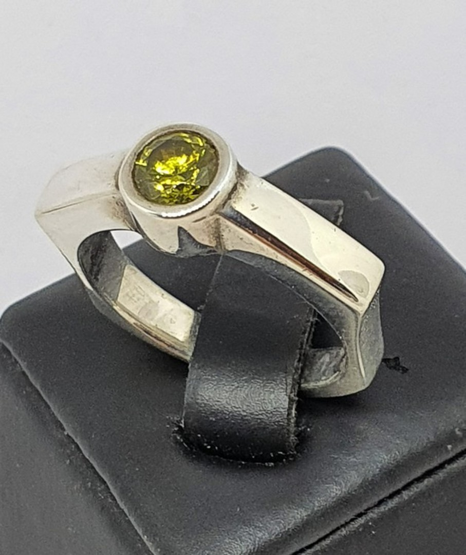 Sterling silver ring with single green gemstone image 0