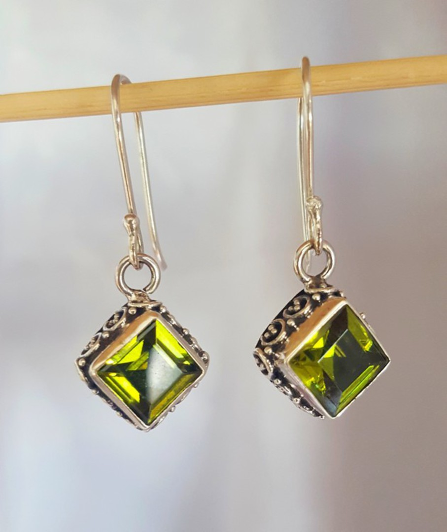 Silver peridot earrings with filigree detail image 1