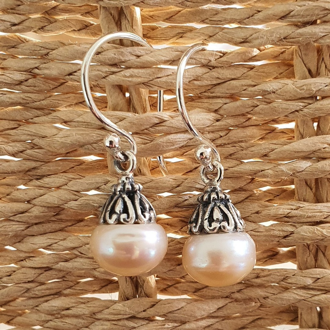 Classic pearl drop earrings with silver detail image 3