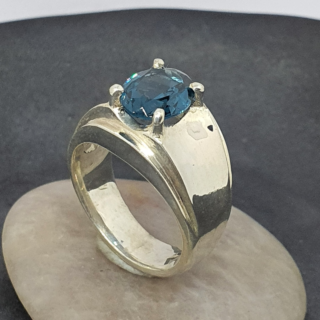 Wide silver band ring with blue topaz simulated gemstone image 0