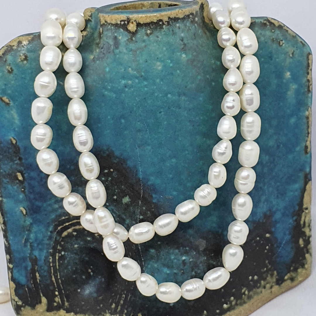 White fresh water pearl strand necklace image 0