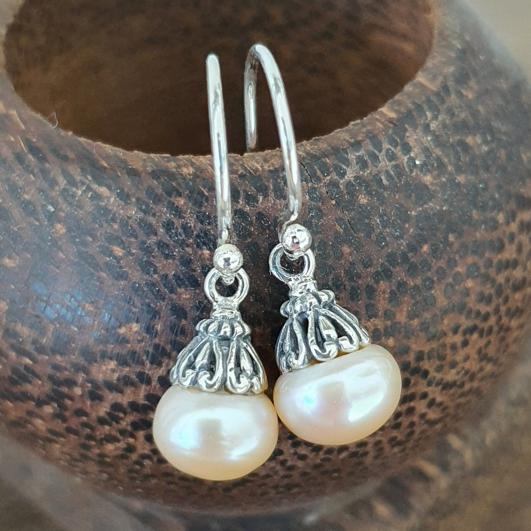 Classic pearl drop earrings with silver detail image 4