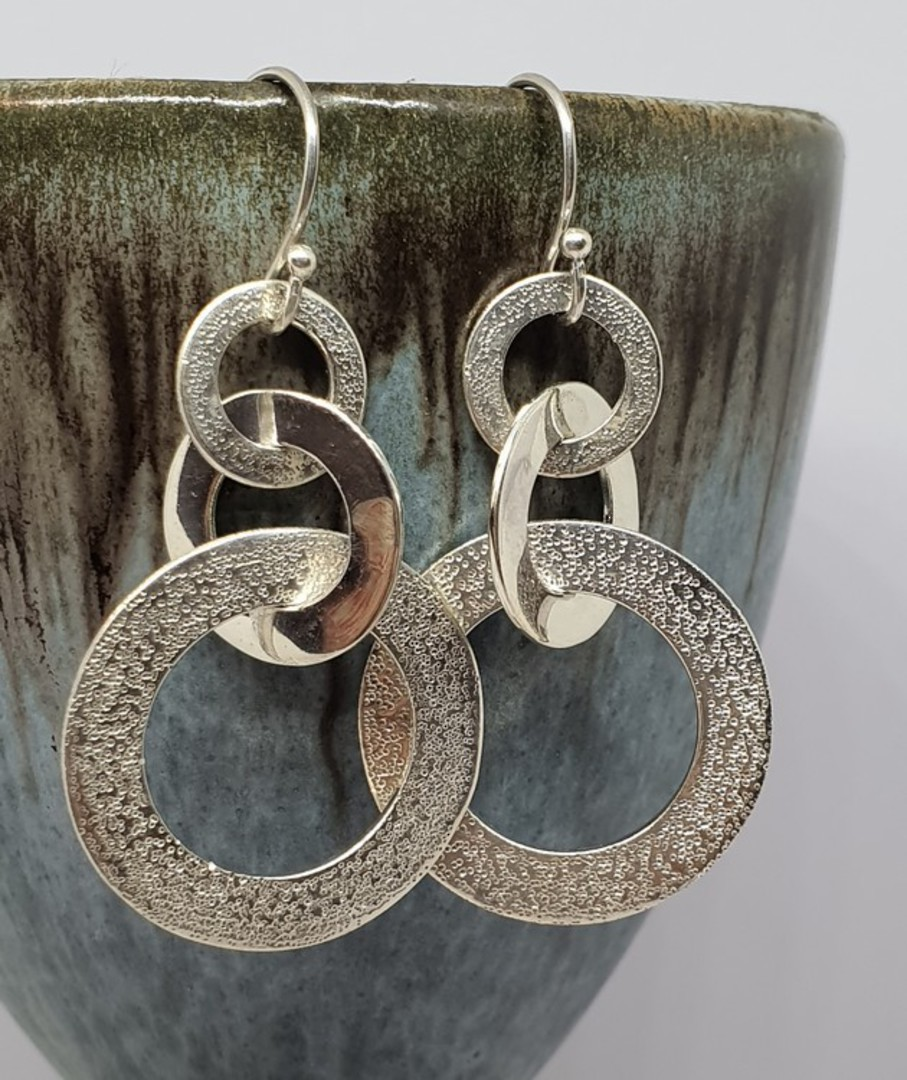 Silver hoop earrings with hammered detail image 2