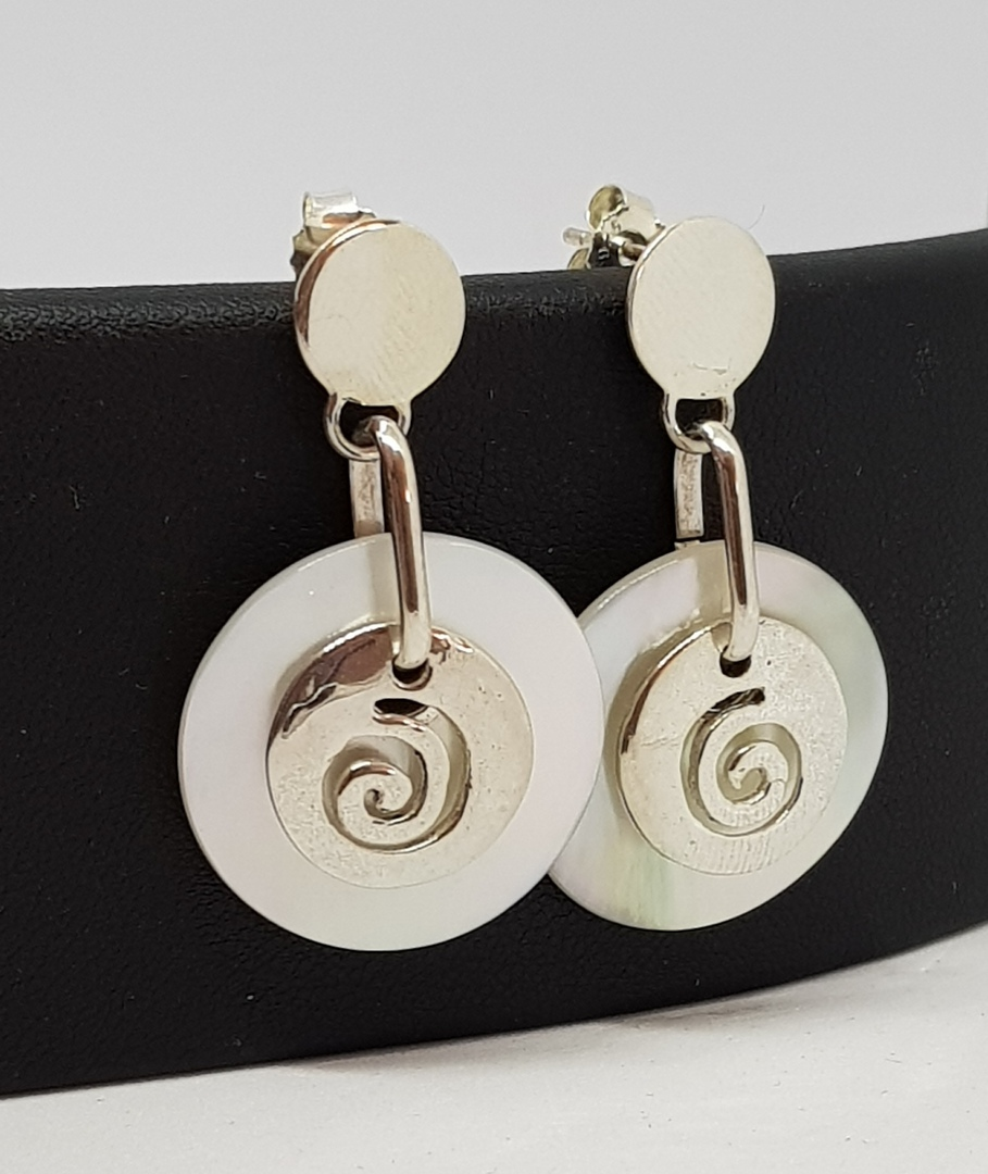 Mother of pearl earrings with silver koru image 1