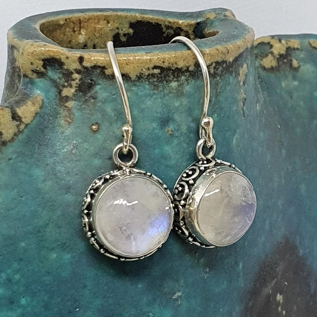 Circular silver moonstone earrings with filigree detailing image 0