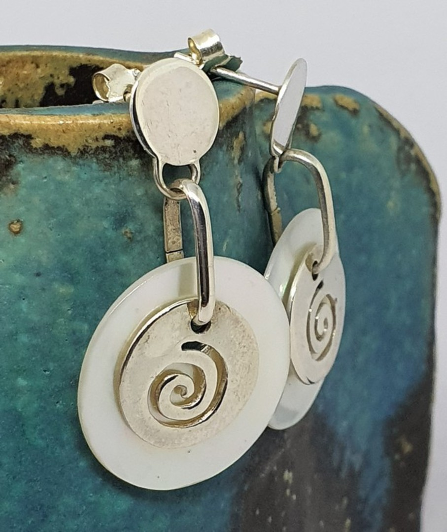 Mother of pearl earrings with silver koru image 0