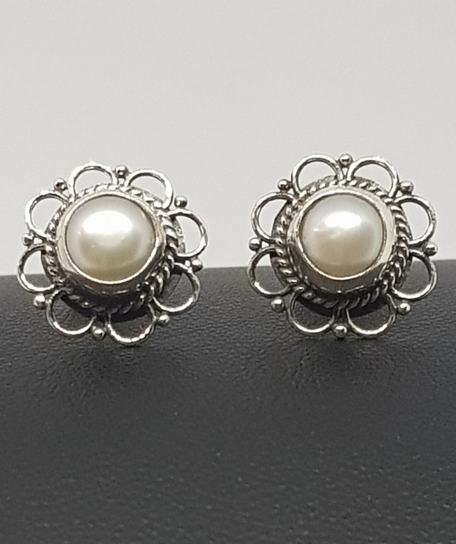 White pearl stud earrings with detailed silver frames image 0