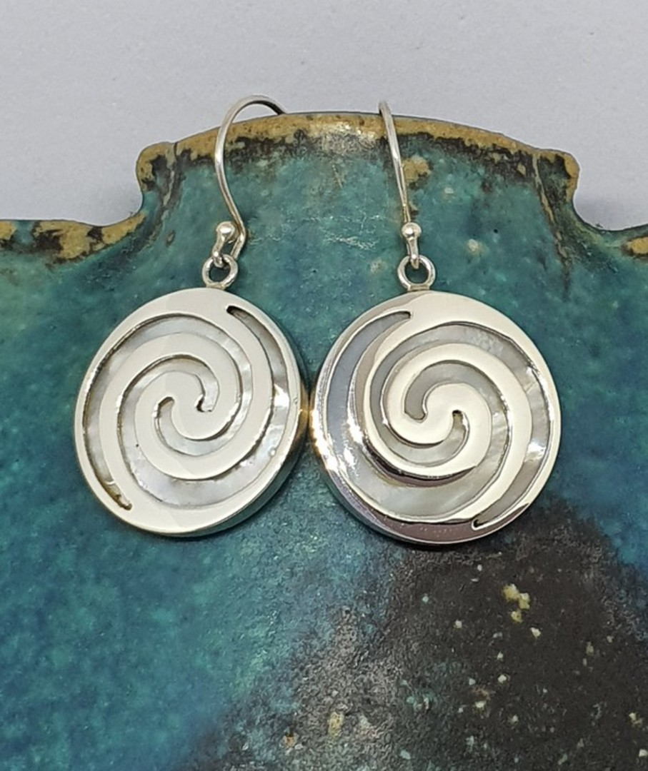 Round mother of pearl earrings overlaid with koru spirals image 0