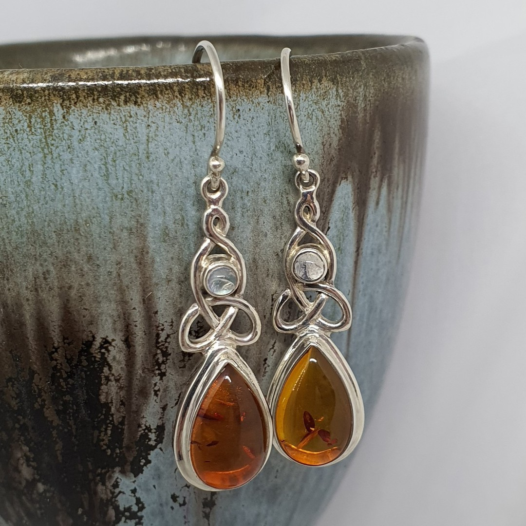 Silver amber earrings with infinity knot and moonstone image 1