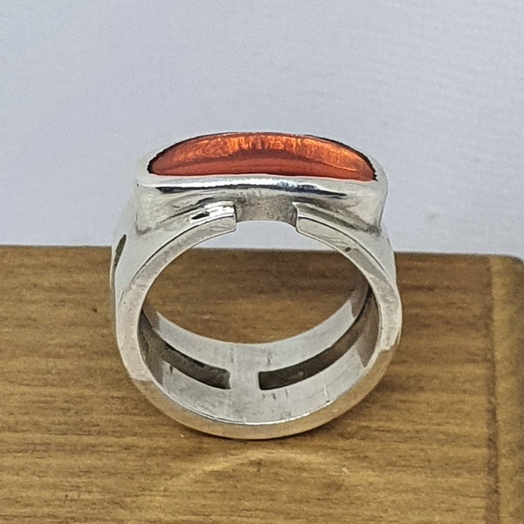 Wide band silver ring with orange stone image 0