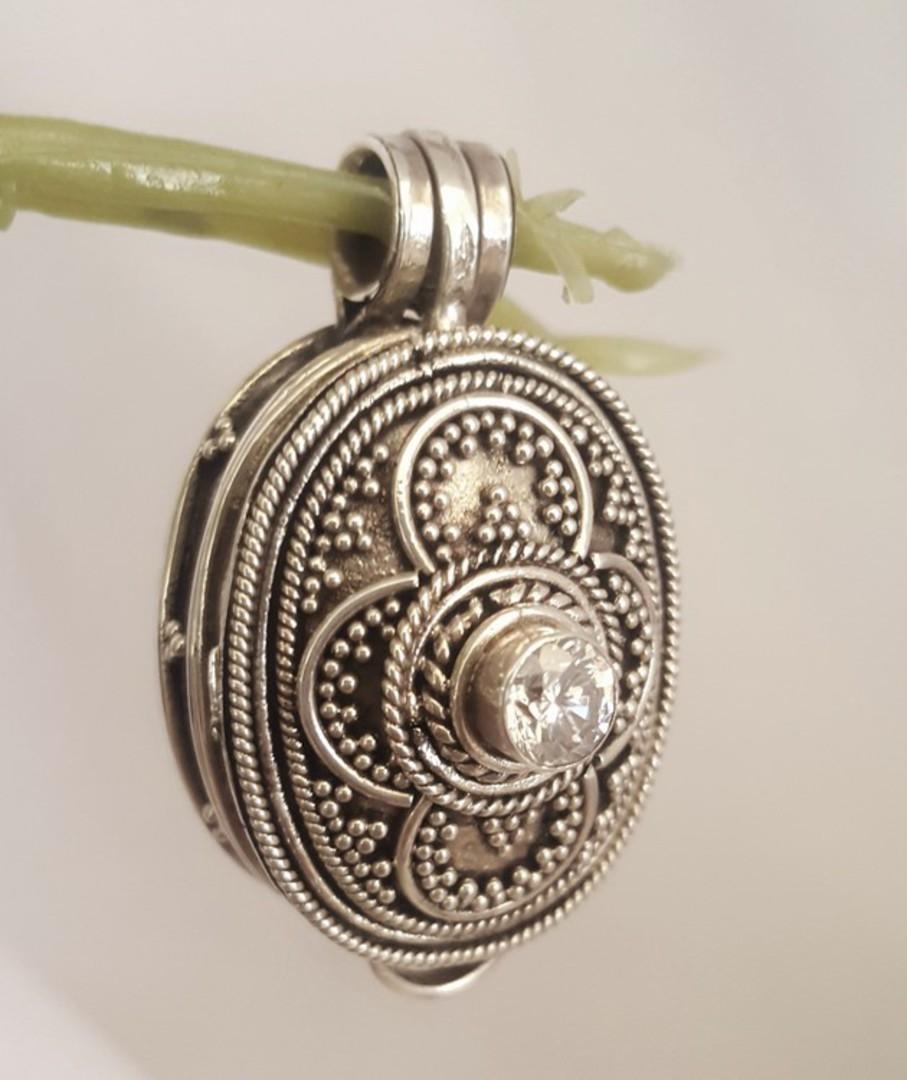 Oval filigree silver prayer or wish box pendant image 0