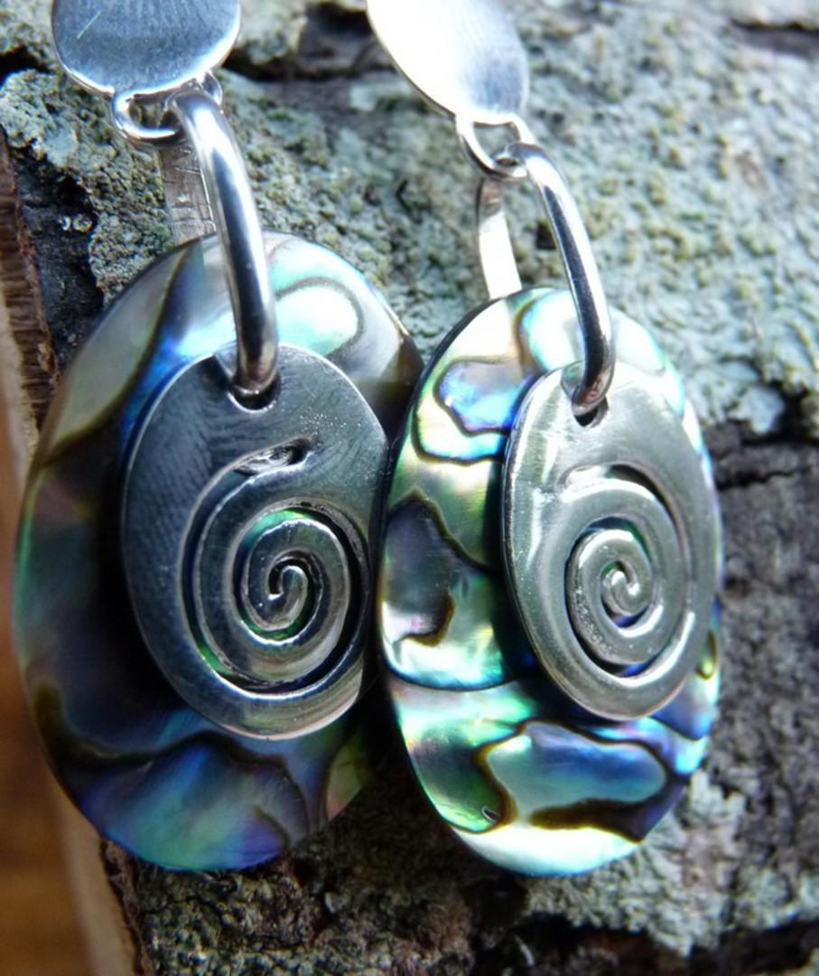 Silver paua shell earrings with silver koru disc image 2