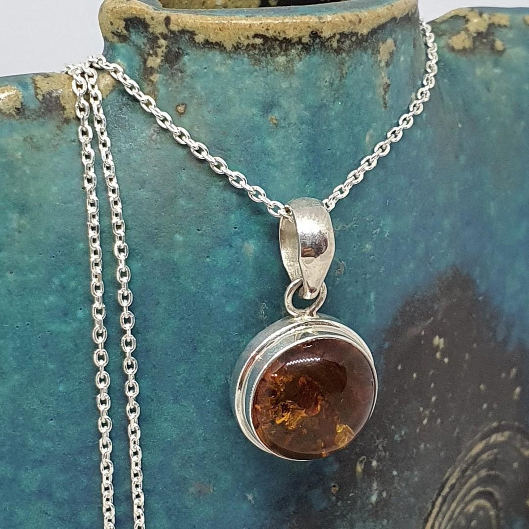 Round amber pendant image 3