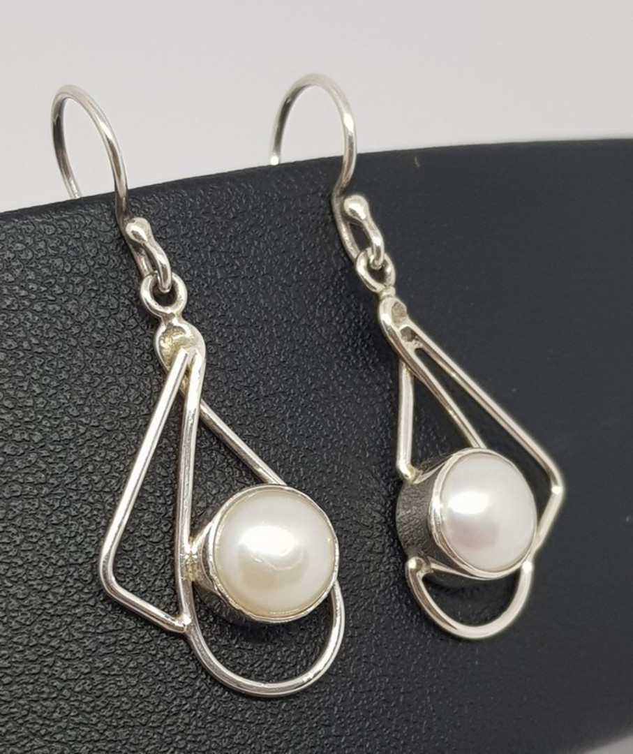 Silver pearl earrings with open silver frame image 0