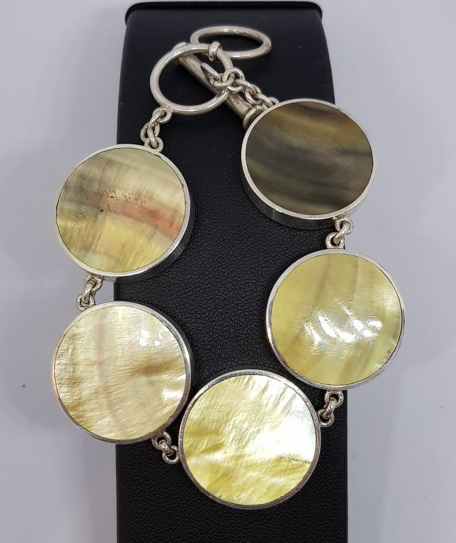 Gold toned shell and silver bracelet image 2