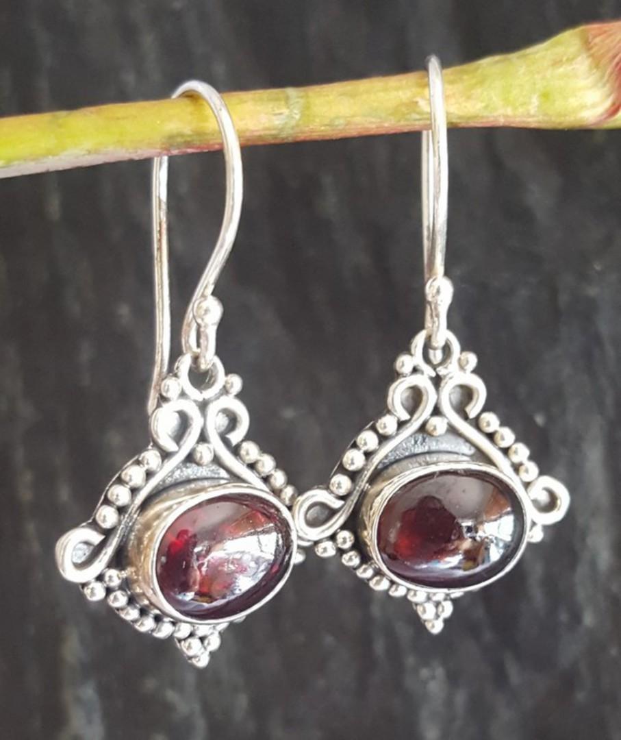 Sterling silver garnet earrings in decorative frame image 1