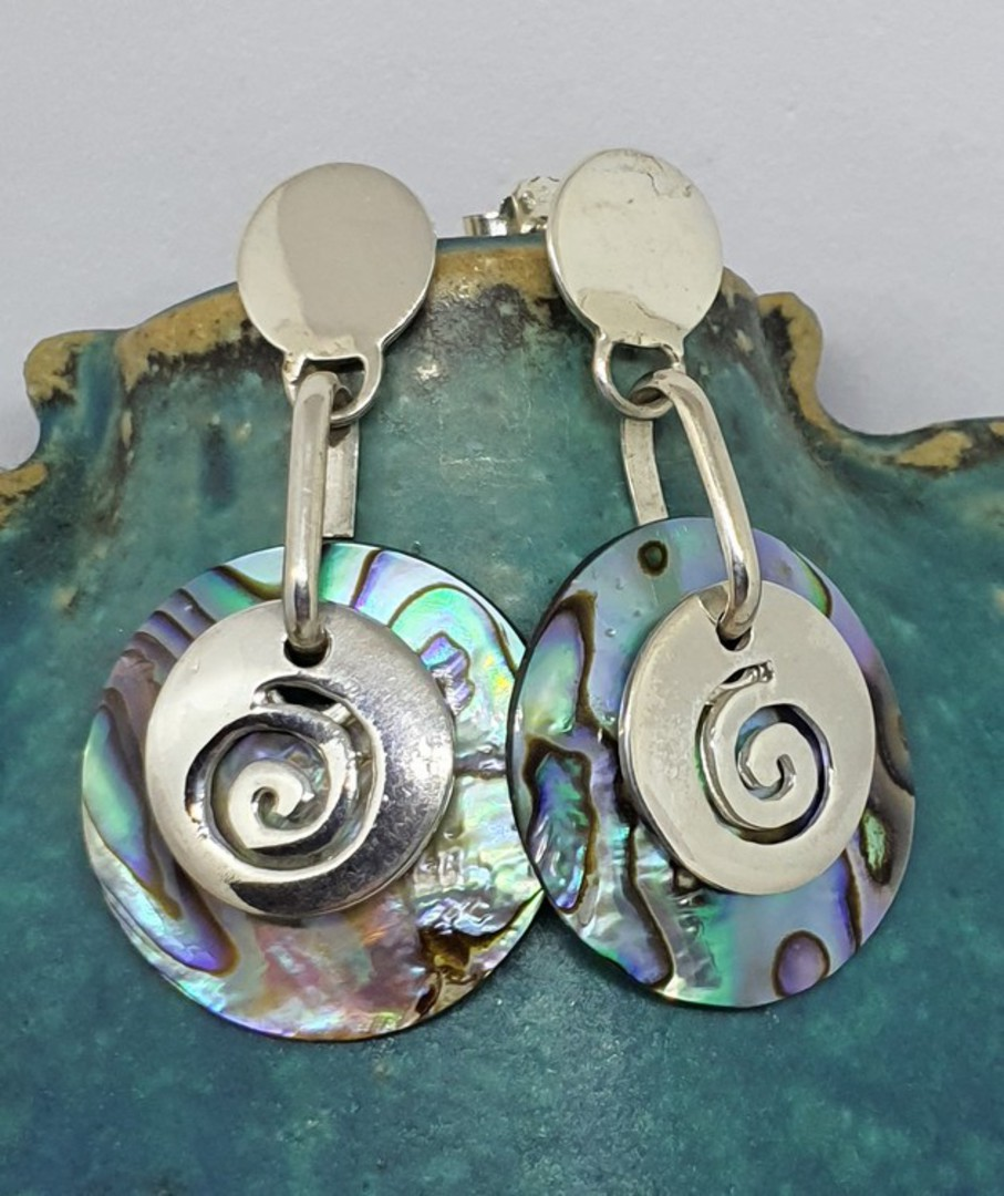 Round silver paua shell earrings with silver koru disc image 0