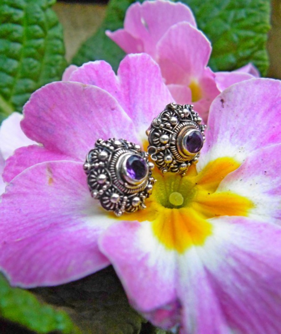 Filigree stud earrings with deep purple gemstone image 1