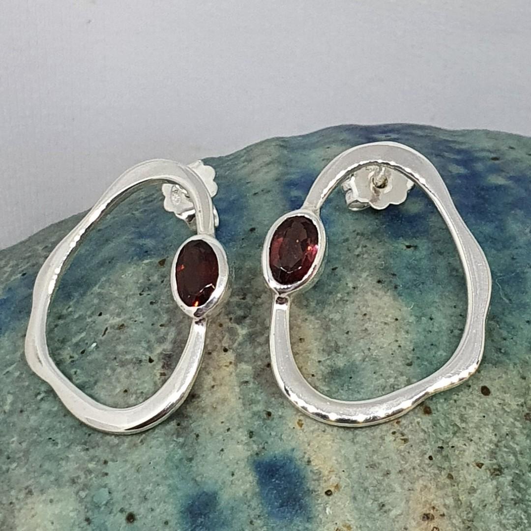 Open wonky oval shape garnet earrings image 1