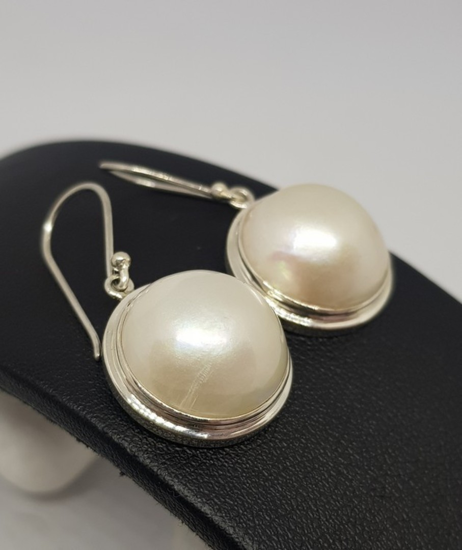 Large white mabe pearl earrings image 1
