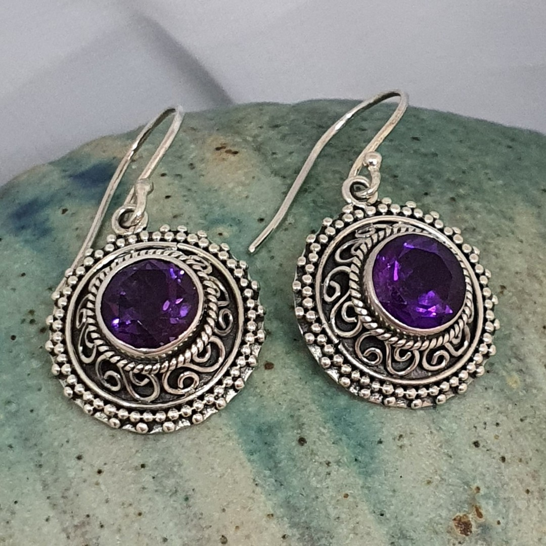 Silver earrings with purple stone image 1