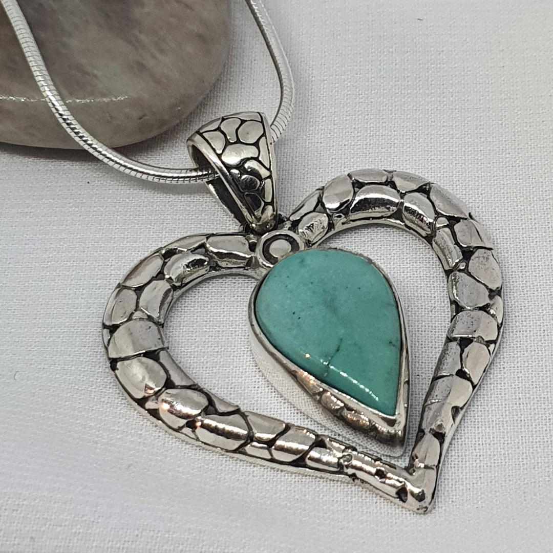 Styerling silver heart pendant with turquopise gemstone image 0