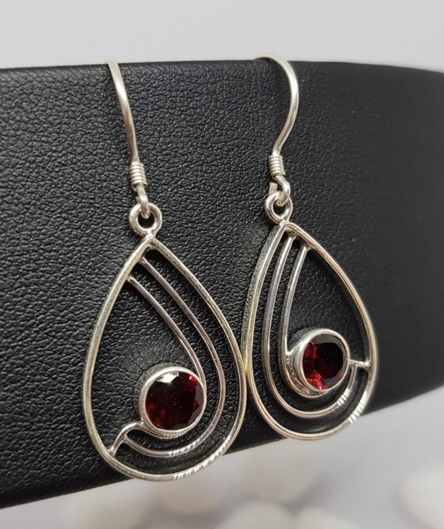 Sterling silver teardrop shaped earrings with garnet image 1