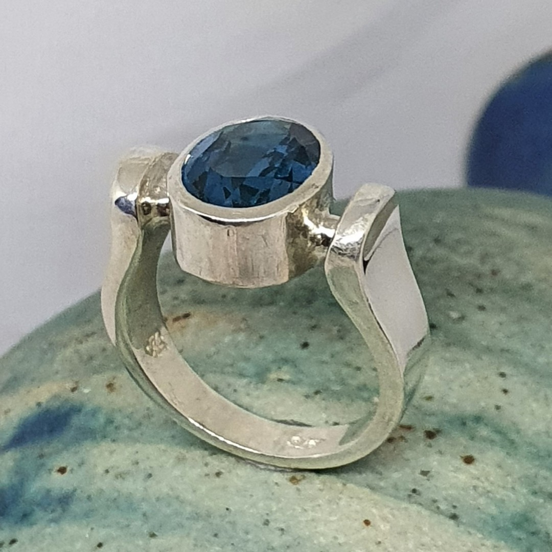Sterling silver ring with deep blue stone image 1