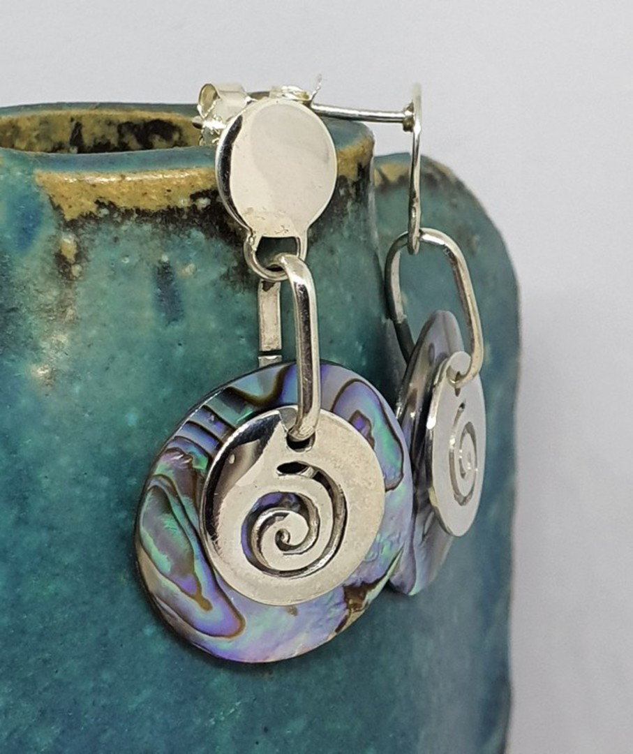 Round silver paua shell earrings with silver koru disc image 1