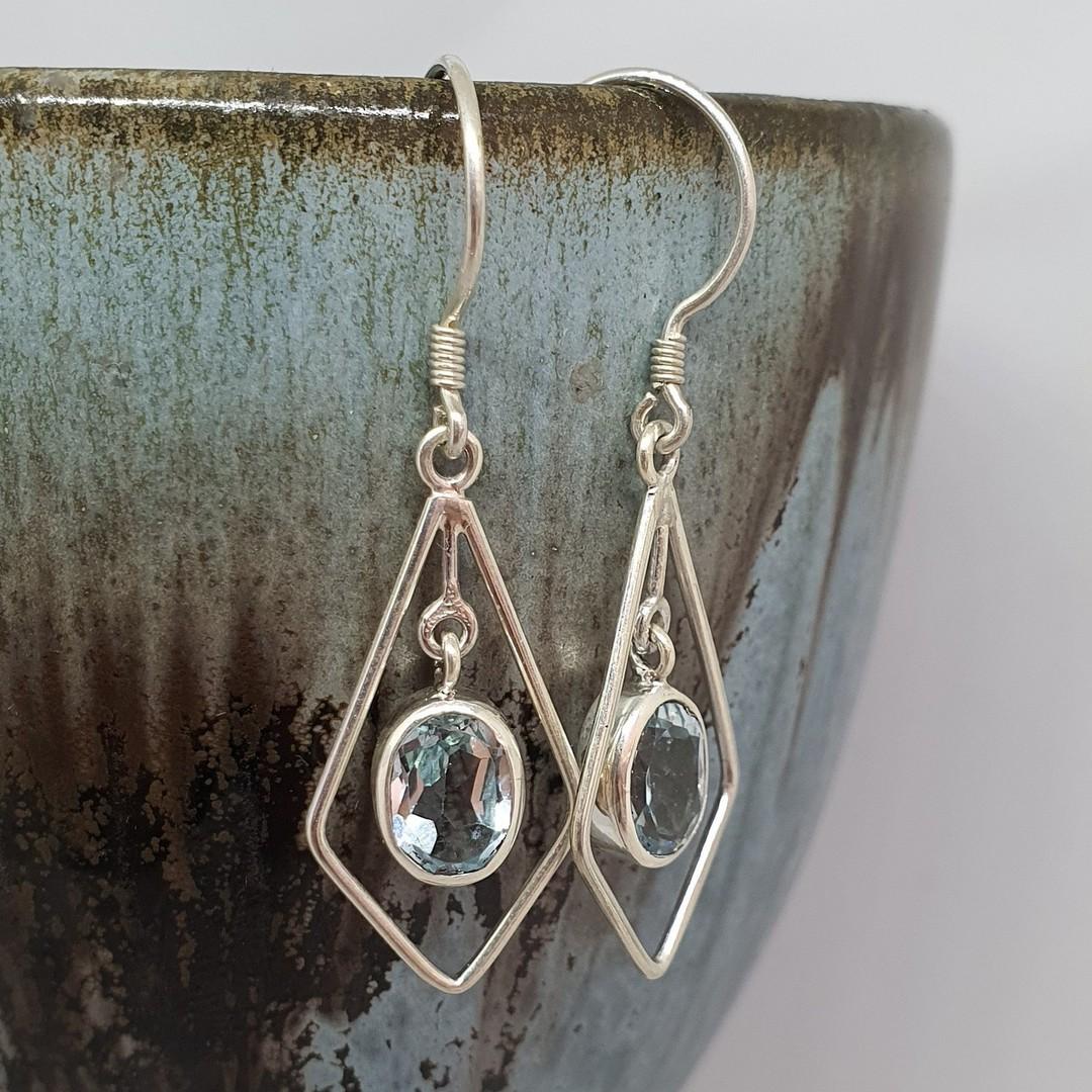 Silver hook earrings with oval blue topaz gemstone image 2