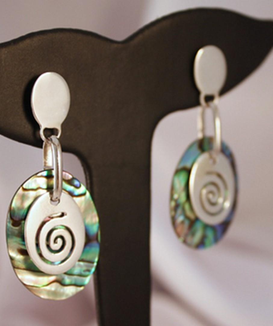 Silver paua shell earrings with silver koru disc image 1